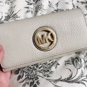Micheal kors wallet (pretty used up)